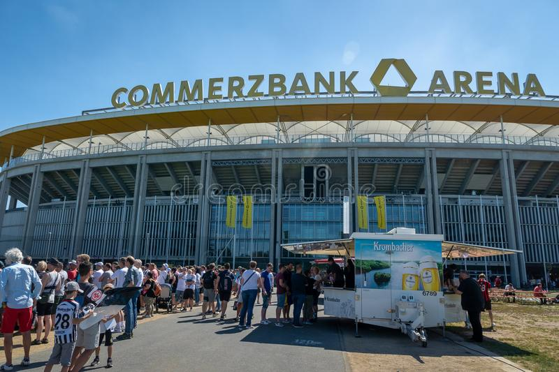 Commerzbank Arena and football fans - home stadium of football club Eintracht Frankfurt. Frankfurt, Germany- July 2019: View of Commerzbank Arena and football stock image