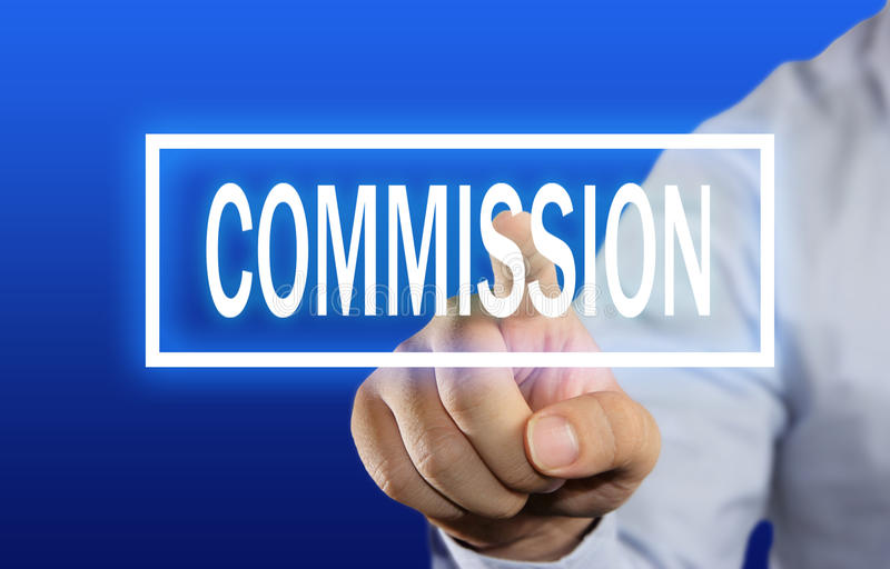 Commission Concept. Business concept image of a businessman clicking Commission button on virtual screen over blue background stock photos