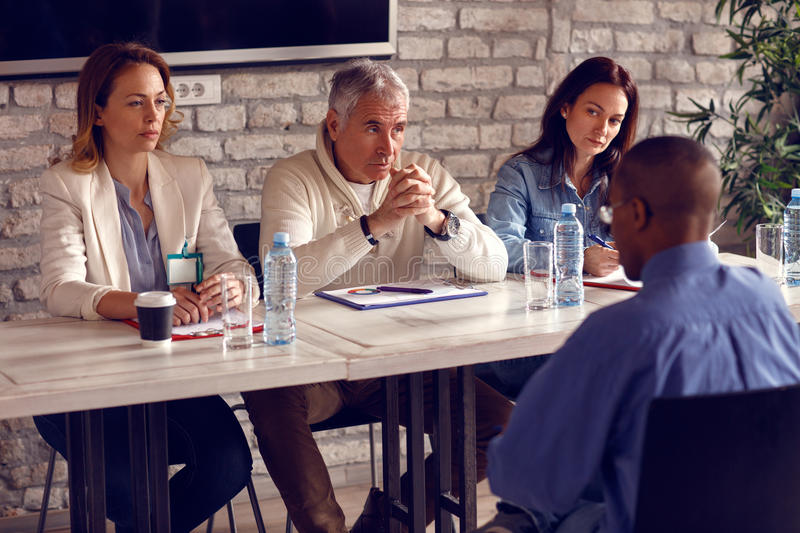 Commission talking with potential worker royalty free stock images