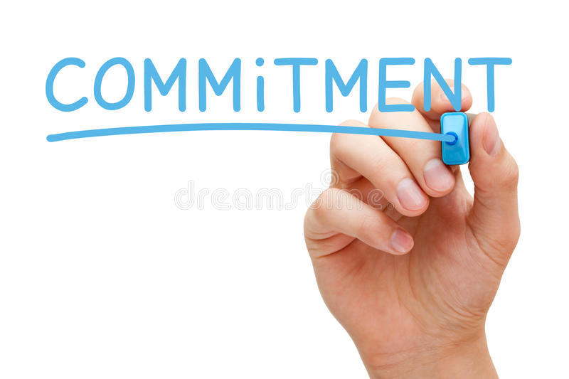 Commitment Blue Marker. Hand writing Commitment with blue marker on transparent wipe board isolated on white stock photo