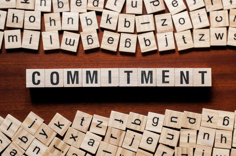 Commitment word concept on cubes royalty free stock photography