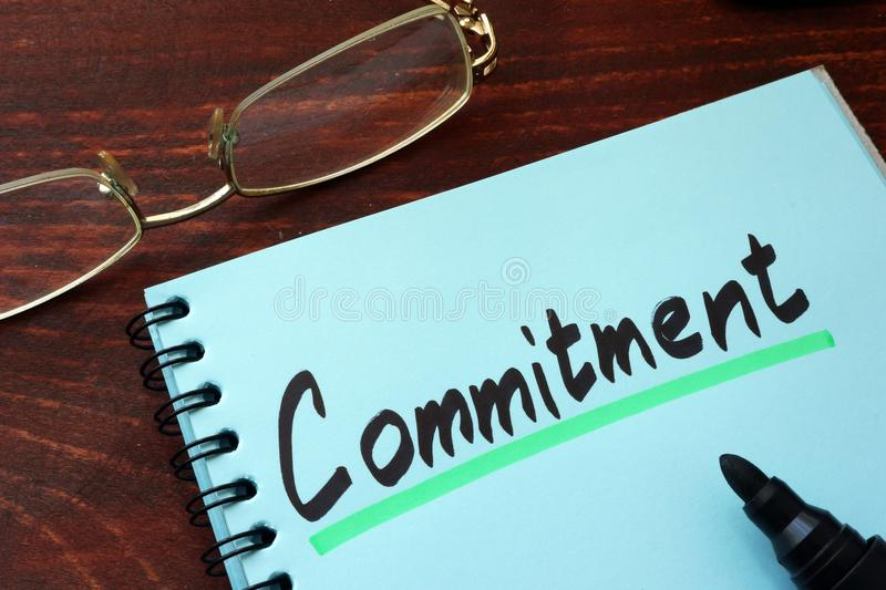 Commitment written on a notepad. Commitment written on a notepad with marker stock photography