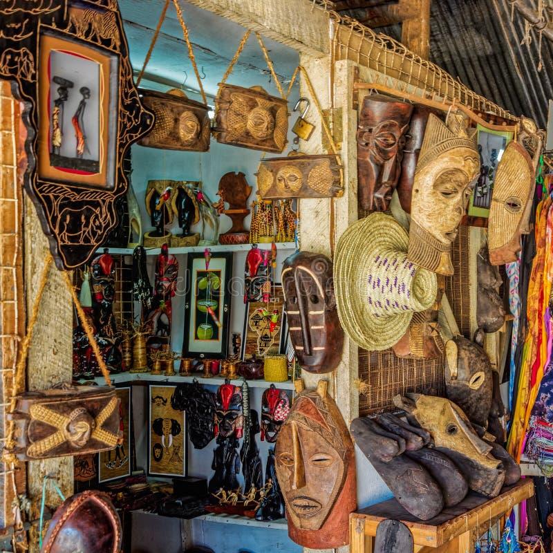 Common African souvenirs and crafts. Close-up view to common African hanmade souvenirs and crafts in souvenir shop at Dar Es Salaam, Tanzania royalty free stock photos