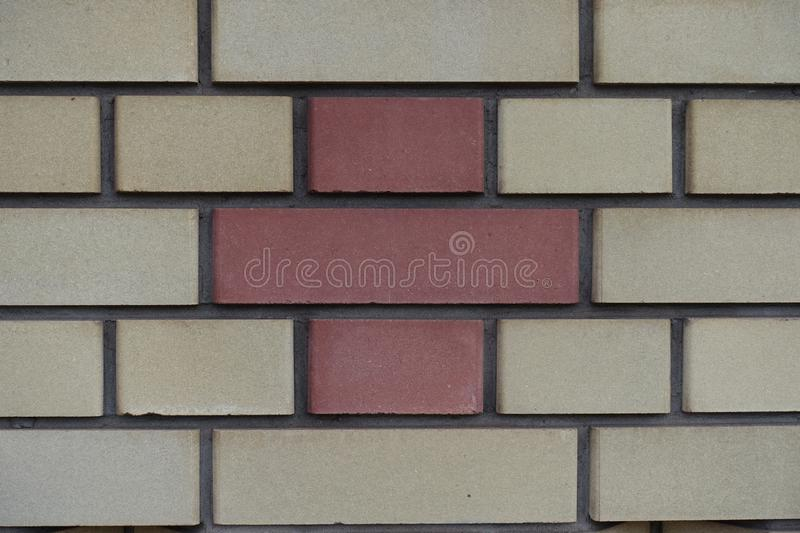 Common bond made of beige and red bricks. Common bond brickwork made of beige and red bricks stock photos