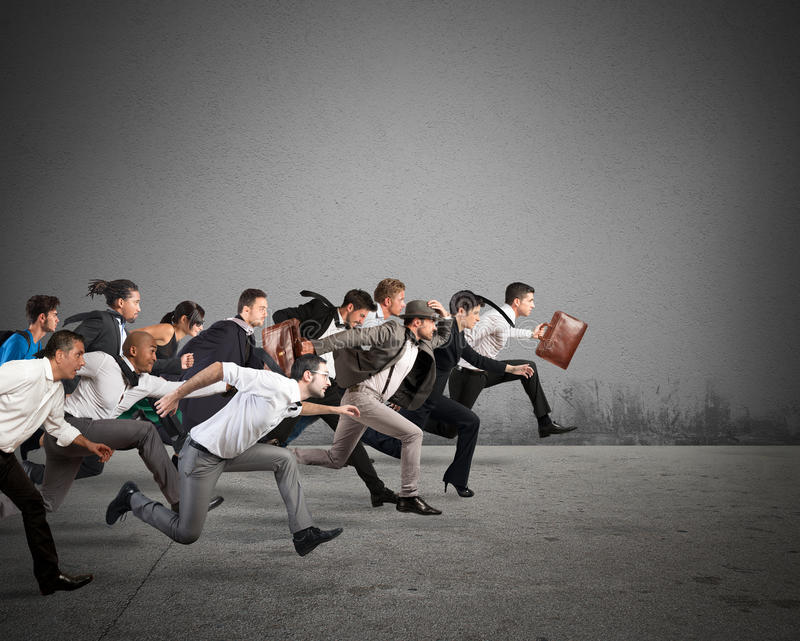 Common business goal. Business people run together in the same direction stock photography