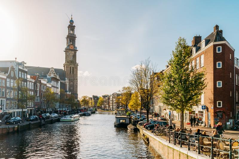 Common Dutch Houses and Houseboats On Amsterdam Canal In Autumn. AMSTERDAM, NETHERLANDS - NOVEMBER 09, 2017: Common Dutch Houses and Houseboats On Amsterdam stock image