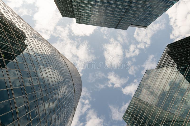 Common modern business skyscrapers, high-rise buildings, architecture raising to the sky, sun. Concepts of financial, economics. Company, glass, bank, blue stock image