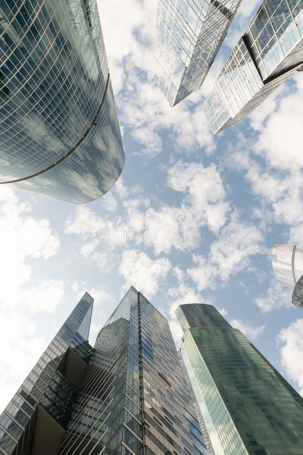 Common modern business skyscrapers, high-rise buildings, architecture raising to the sky, sun. Concepts of financial, economics. Company, glass, bank, blue royalty free stock images