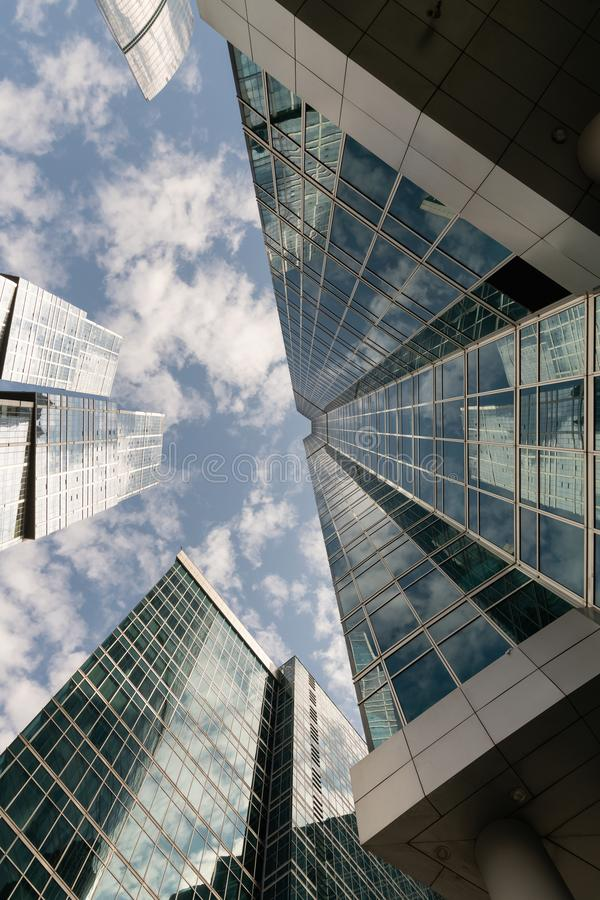 Common modern business skyscrapers, high-rise buildings, architecture raising to the sky, sun. Concepts of financial, economics. Company, glass, bank, blue stock photo