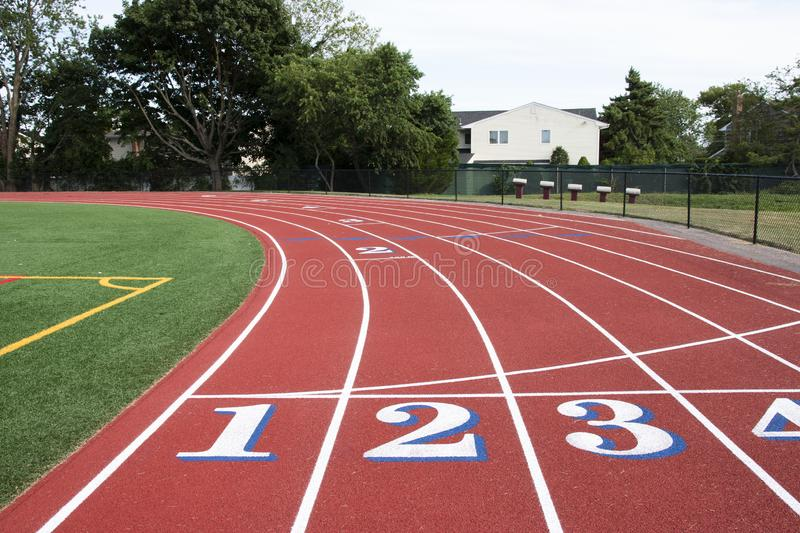 Common start-finish line of a red track with white numbers with blue trim royalty free stock images