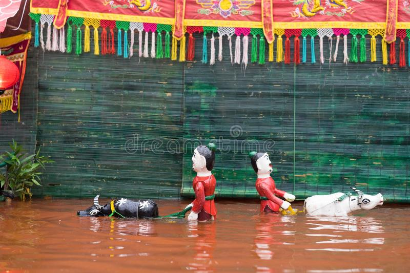 A common Vietnamese traditiA common Vietnamese traditional water puppetry showonal water puppetry show. A common Vietnamese traditional water puppetry show stock photo