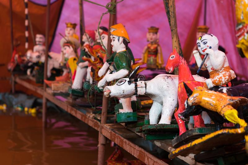 Common Vietnamese water puppets behind puppetry state. The control room is dark to hide puppeteers and instruments.  royalty free stock photo