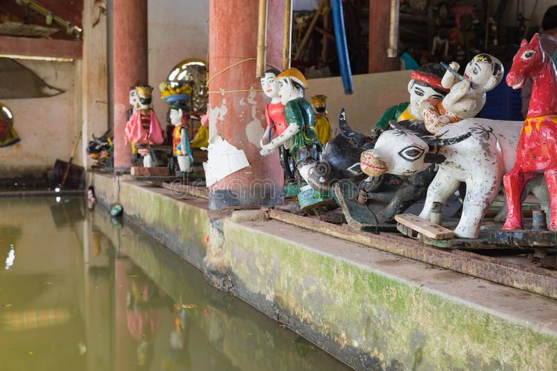Common Vietnamese water puppets behind puppetry state in Dao Thuc village. The control room is dark to hide puppeteers and instrum. Ents royalty free stock images