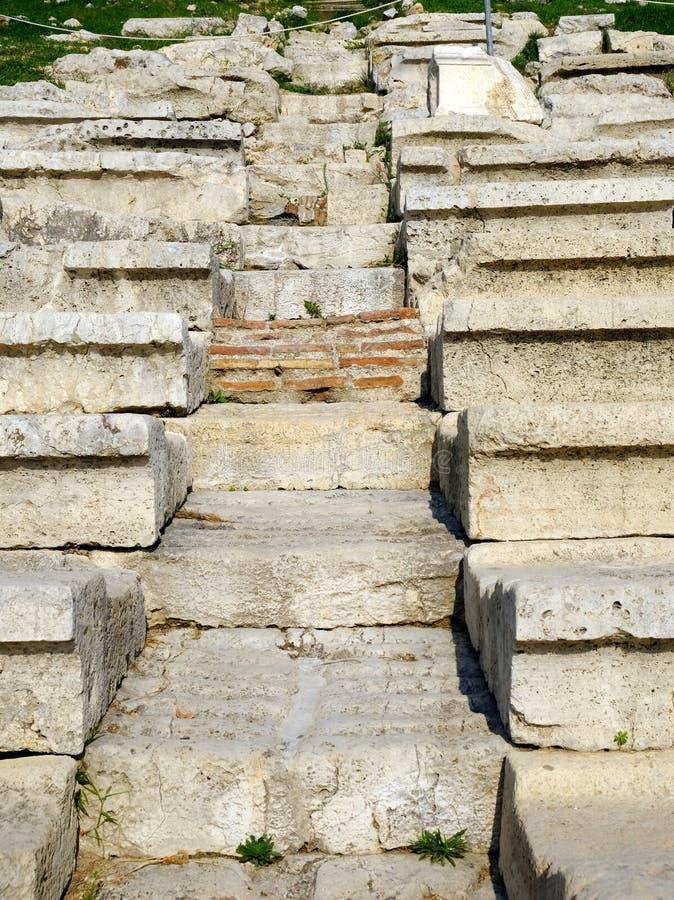 Commonersplaatsing, Theater van Dionysus, Athene, Griekenland stock afbeeldingen
