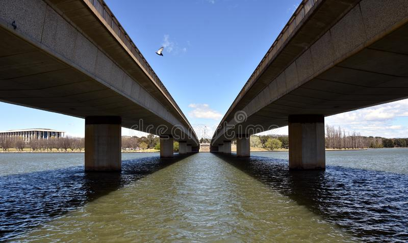 Commonwealth Bridge over Lake Burley Griffin in Australia capital city Canberra. Australian Parliament House at the end of the. Bridge. Bridges two road route stock image