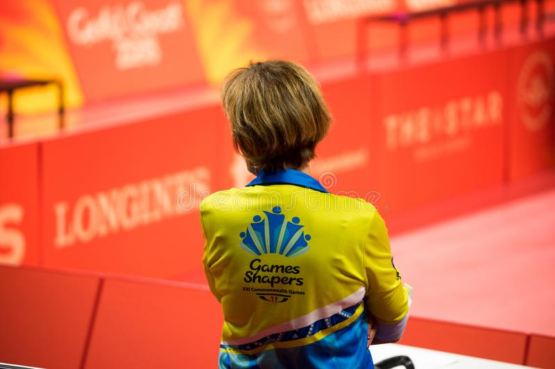 2018 Commonwealth Games Official. An official watching during the semi-finals games of the table tennis games during the 2018 Commonwealth Games held in royalty free stock image