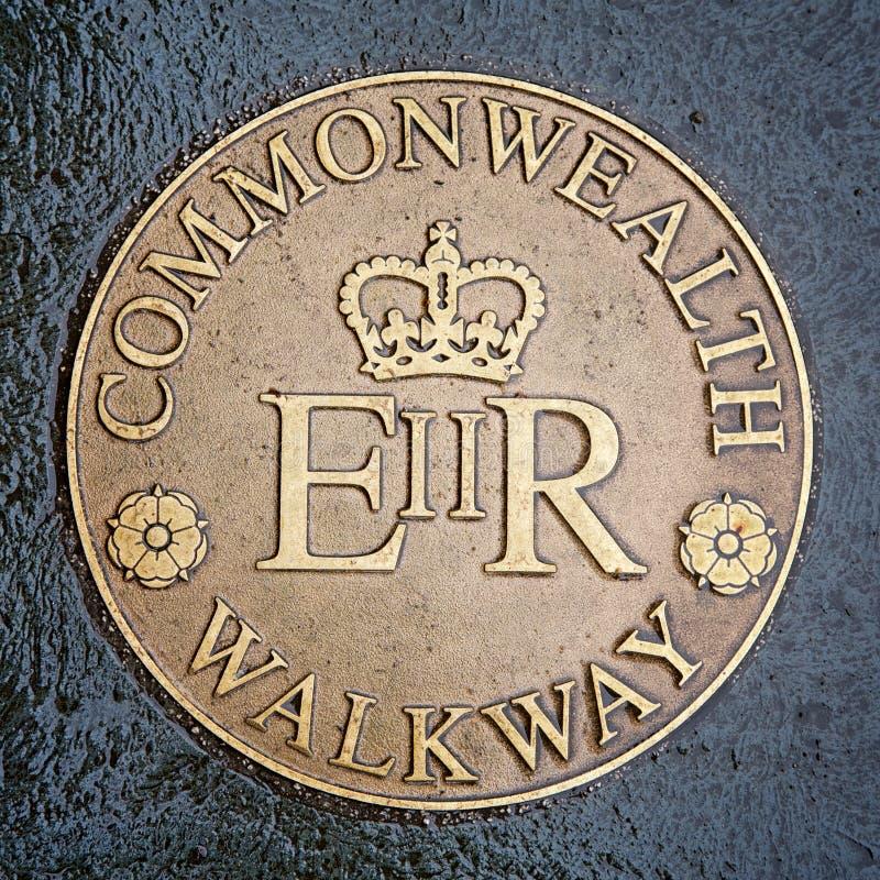 Commonwealth Walkway brass plaque stock photo