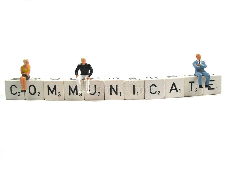 Communicate. Couple of people sitting on the word communicate