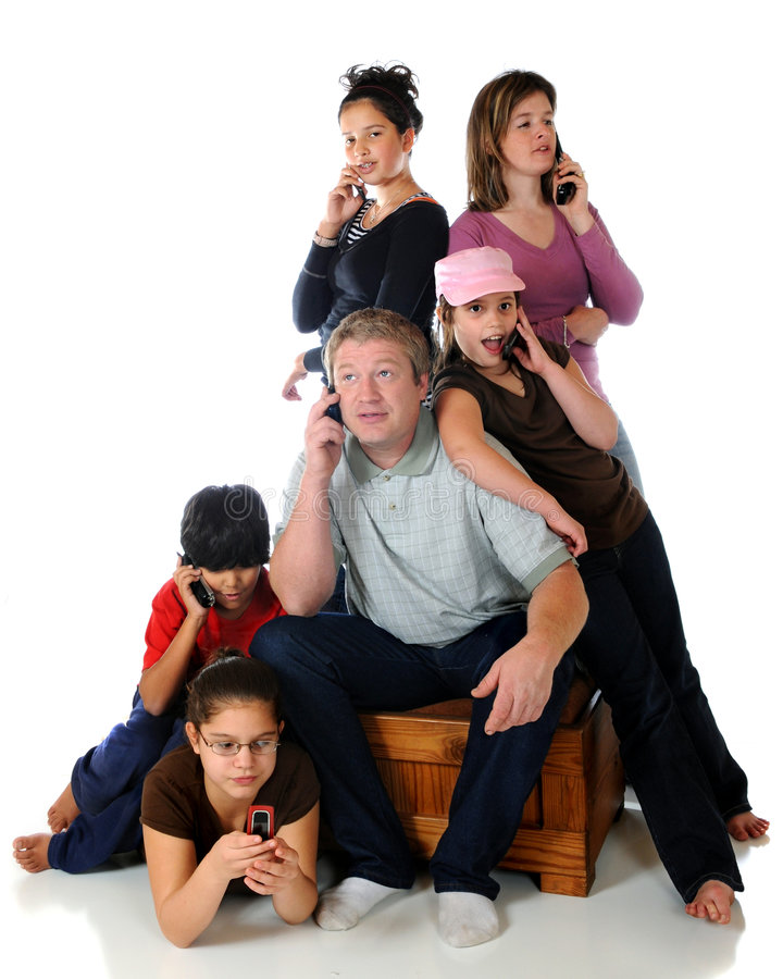 Communicating. Portrait of six people, both adults and kids, all communicating on their cell phones. Isolated on white stock image