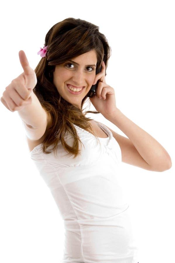 communicating female showing thumbs up στοκ εικόνα με δικαίωμα ελεύθερης χρήσης