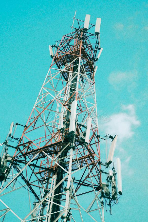 Communication antenna tower radio television digital wireless station technology against blue sky background stock photography
