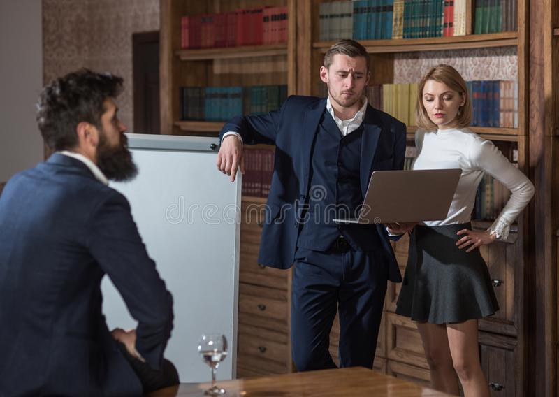 Communication concept. Team communication to achieving better result. Business communication between young professionals. In library. Effective communication royalty free stock images