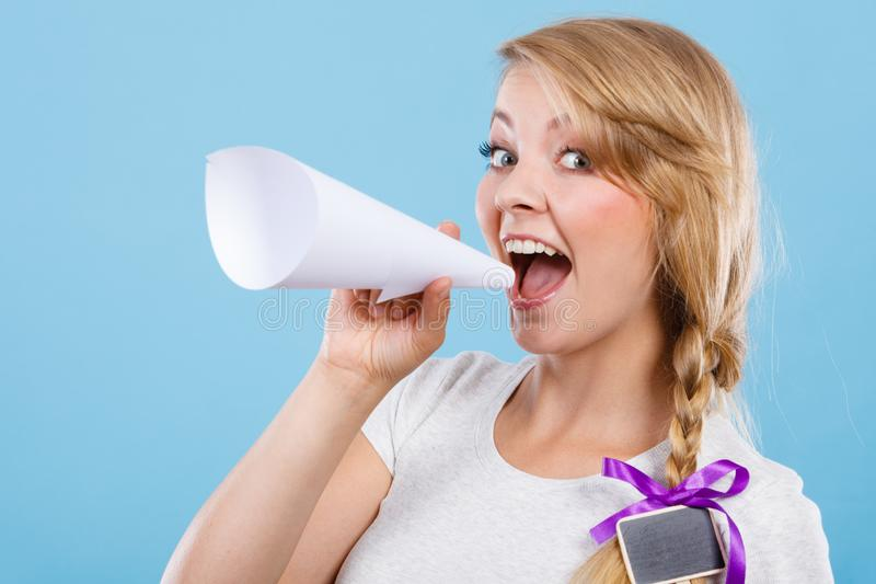 Woman screaming through megaphone made of paper royalty free stock image
