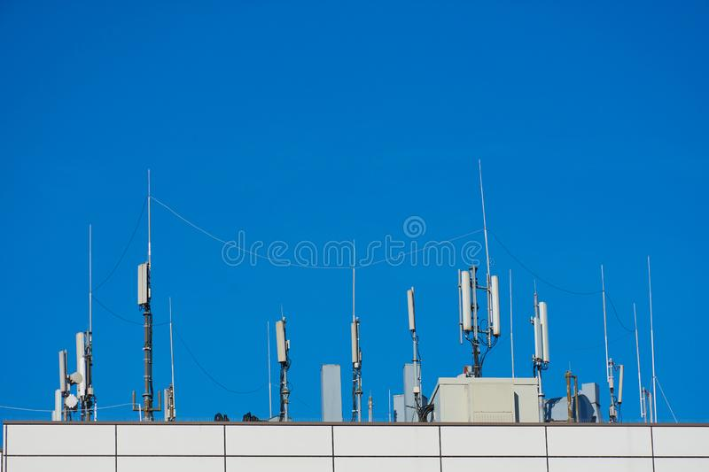 Communication equipment on a rooftop stock image