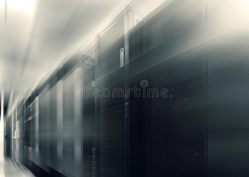 Communication equipment room with lighting in data center with blur and motion. Communication equipment room with lighting in data center royalty free stock photo