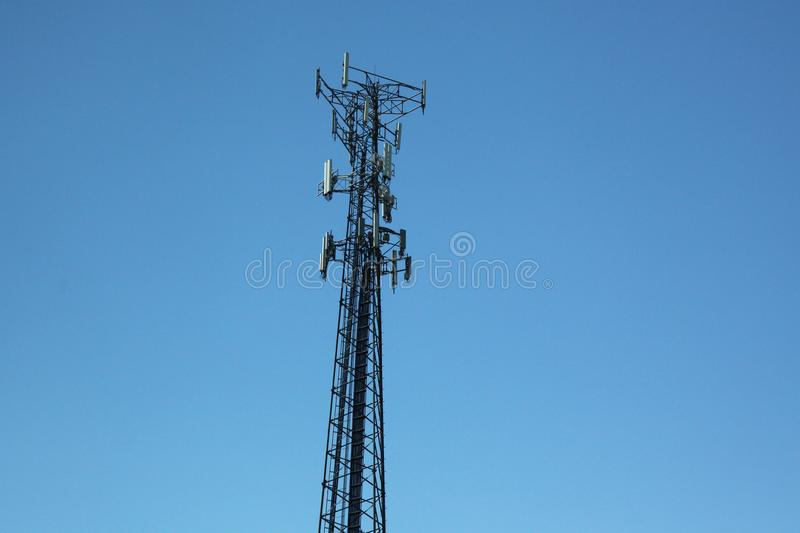Communication iron pole in blue sky.  royalty free stock photography