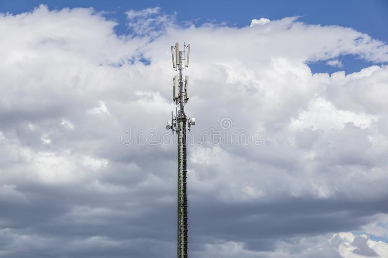 Communication pole on blue sky with cloud stock photography