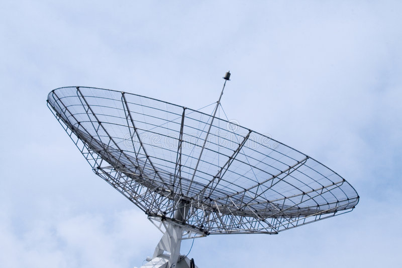 Communication radar on a cloudy sky stock images