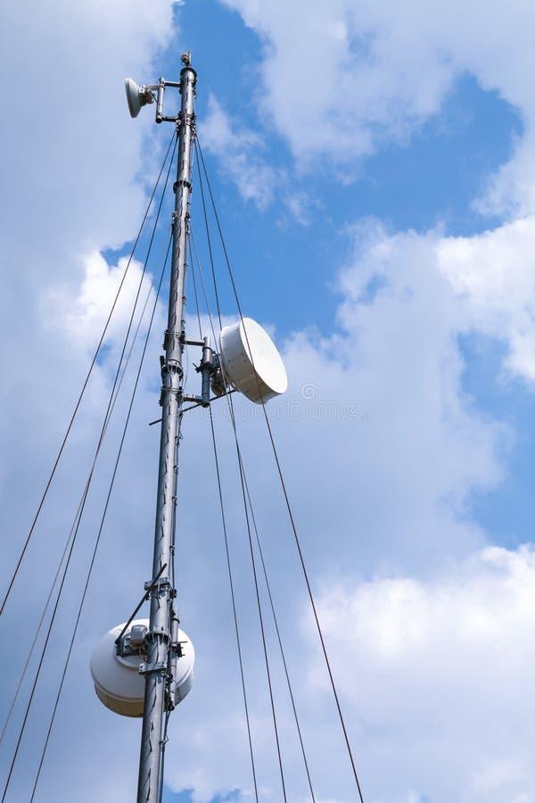 Communication radio tower above blue sky background royalty free stock photos