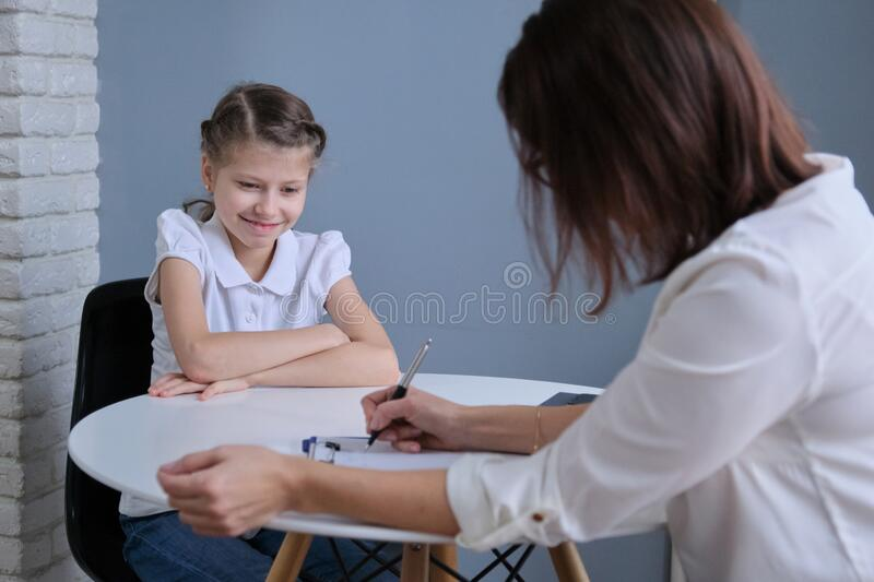 Communication session of school psychologist and girl child royalty free stock images