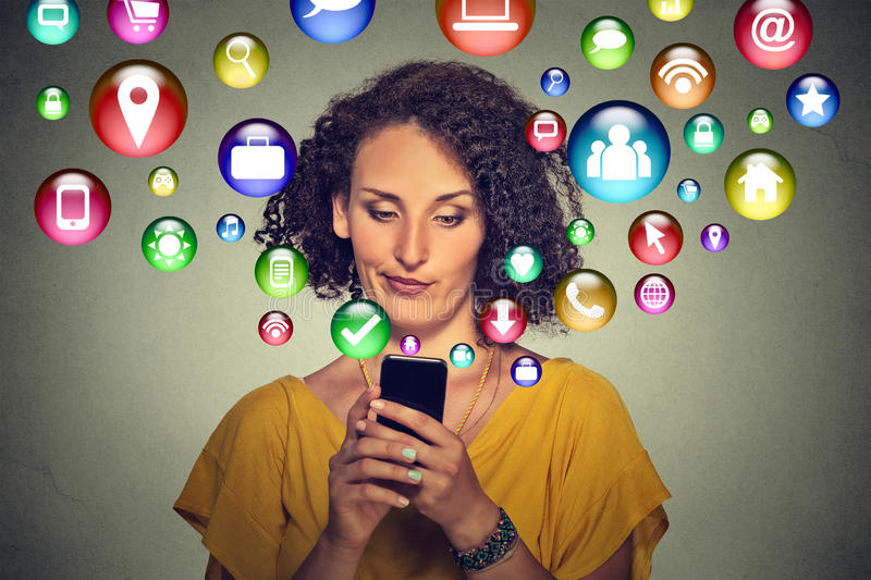 Communication technology mobile phone tech concept. Annoyed woman using smartphone stock image