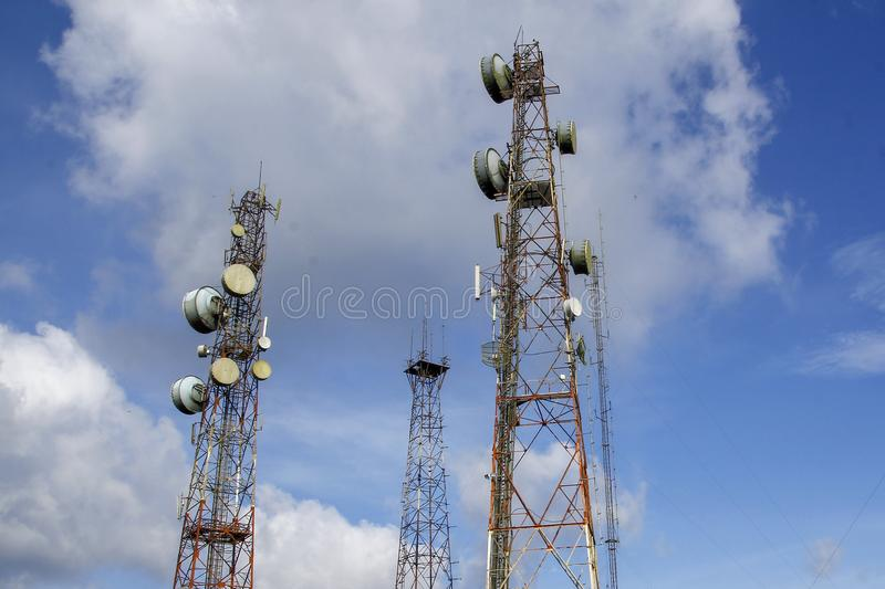 Communication and telecommunication pole in nature on blue sky at asia. Tower telephone worker background working technology antenna equipment business high royalty free stock image