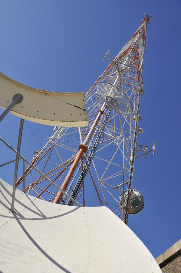 Communication Tower. Telecommunication Tower and Microwave Dish for Wireless Cellular Service stock photo