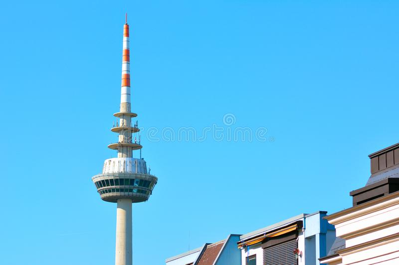 Communication tower in city Mannheim called `Fernmeldeturm` in Germany in front of blue sky royalty free stock image