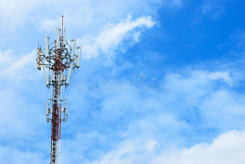 Communication world. Communication pole with the blue sky background stock photo