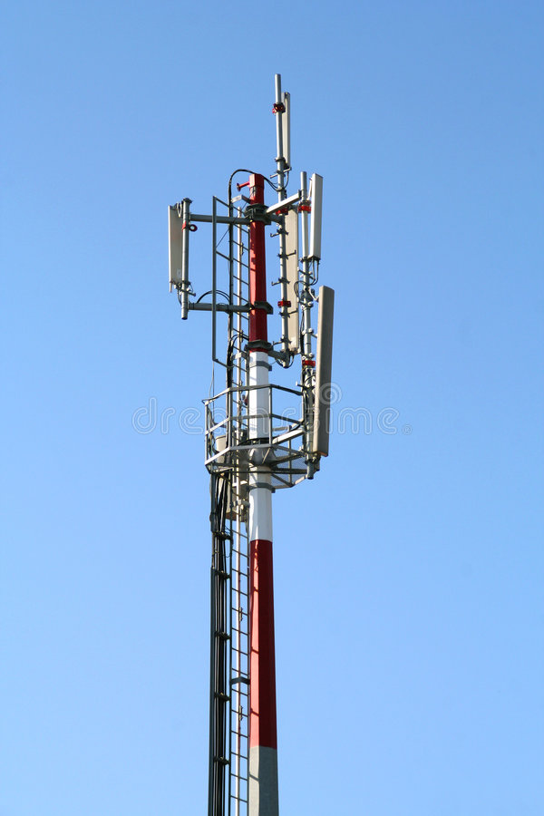 Communications antenna. Over a clean blue sky stock photo