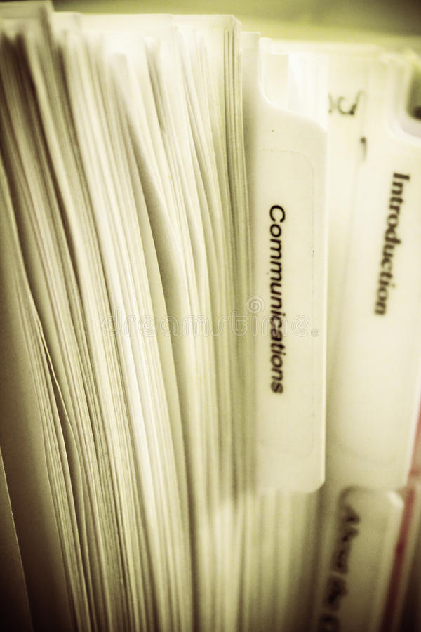 Communications Manual. An image depicting a business manual with communications being the target subject royalty free stock photos