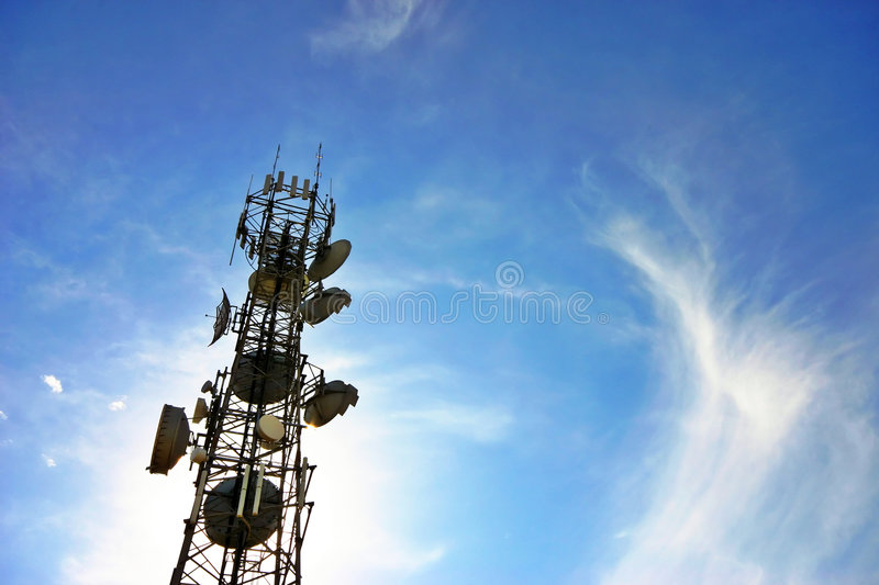 Communications tower. A communications tower for tv and mobile phone signals stock image