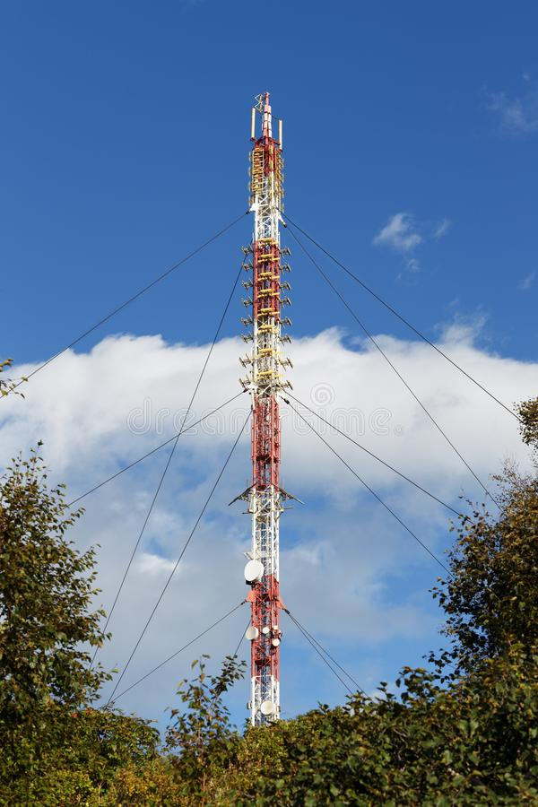 Communications tower with antennas wireless communication channels stock photography