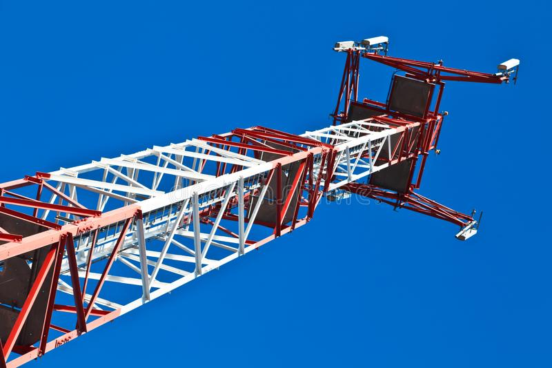 Communications Tower with a blue background royalty free stock photography