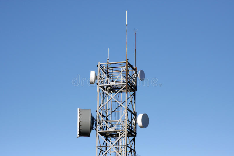 Communications tower with radio and microwave links stock photography
