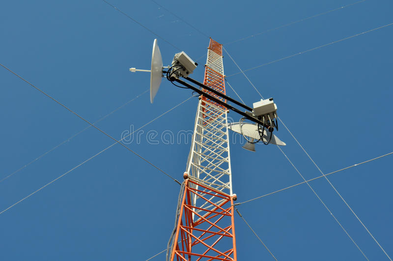 Communications Tower. View from below of a Communications Tower with satellite dishes, ISP stock image