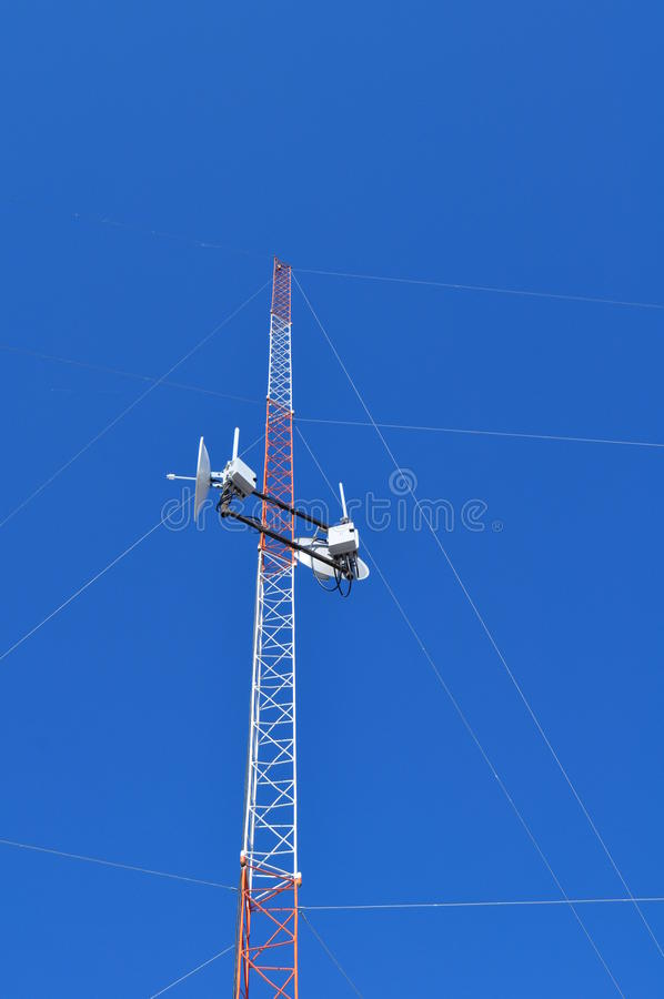 Communications Tower. View from below of a Communications Tower with satellite dishes, ISP royalty free stock image