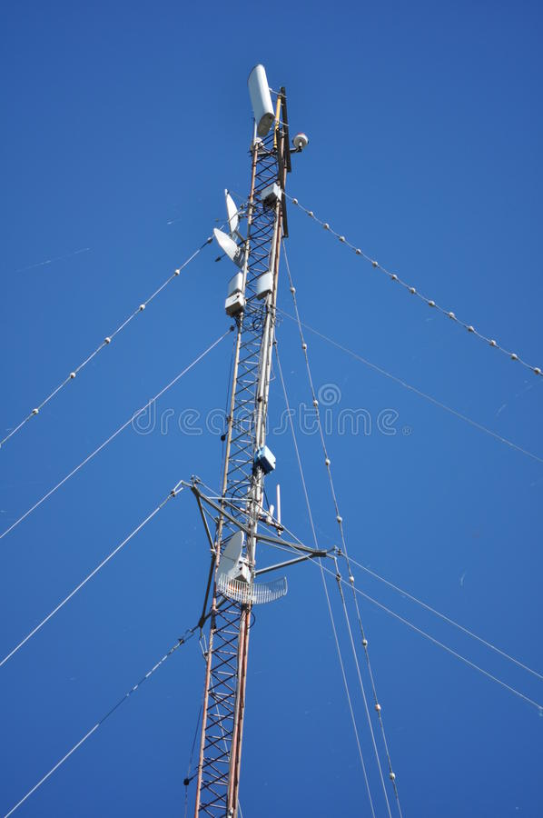 Communications Tower. View from below of a Communications Tower with satellite dishes, ISP royalty free stock photos