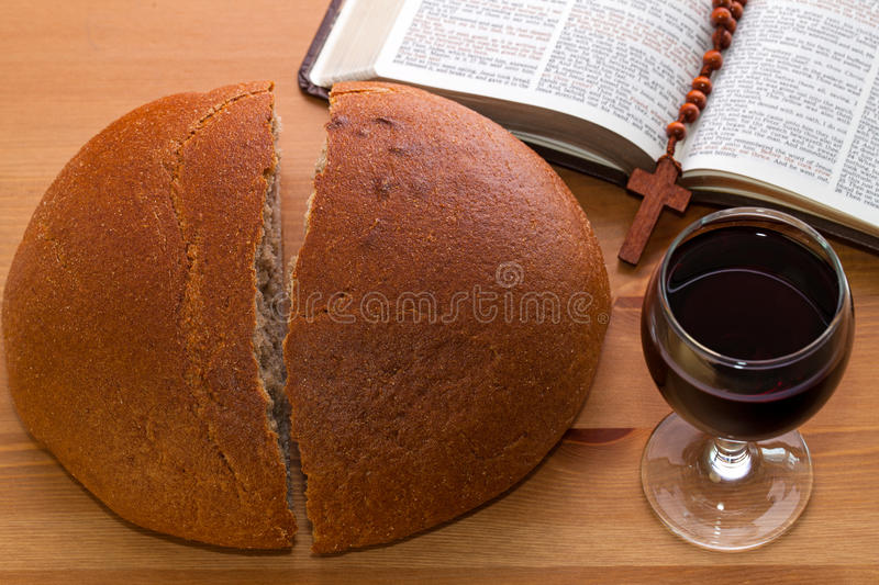 Communion, Bread, Wine And Bible On The Table Stock Photo