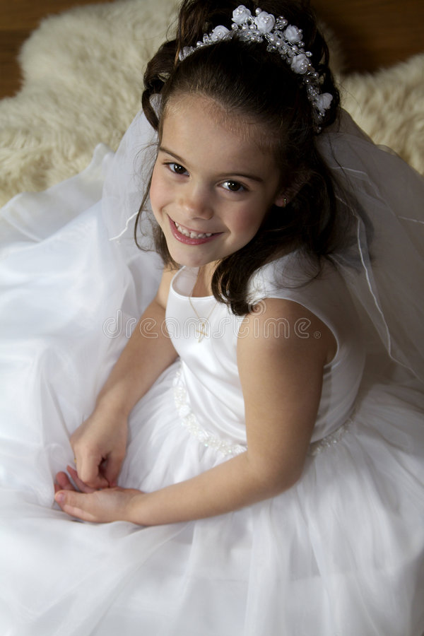 Communion Girl. Portrait of a little girl in communion dress and veil stock photos